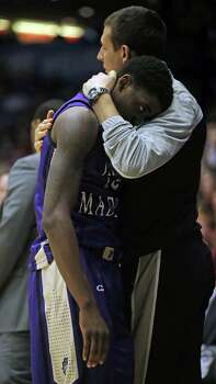 James Madison's Andre Nation is consoled following an 83-62 loss against Indiana in the second round of the NCAA Tournament at the University of Dayton Arena in Dayton, Ohio, on Friday, March 22, 2013. (Brian Cassella/Chicago Tribune/MCT) Photo: Brian Cassella, McClatchy-Tribune News Service / Chicago Tribune
