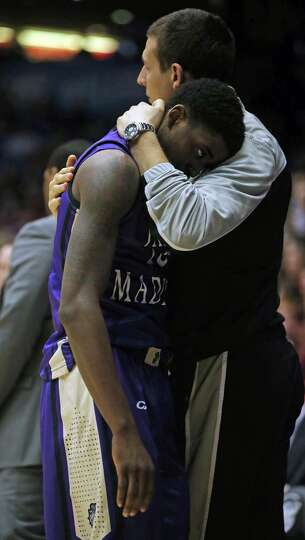 James Madison's Andre Nation is consoled following an 83-62 loss against Indiana in the second round