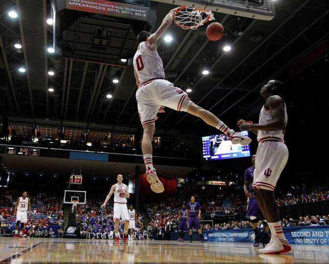 Indiana's Will Sheehey (0) dunks off a steal against James Madison during the second half in the sec