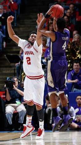 Christian Watford #2 of the Indiana Hoosiers defends Charles Cooke #4 of the James Madison Dukes. Photo: Joe Robbins, Getty Images / 2013 Getty Images