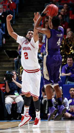 Christian Watford #2 of the Indiana Hoosiers defends Charles Cooke #4 of the James Madison Dukes.