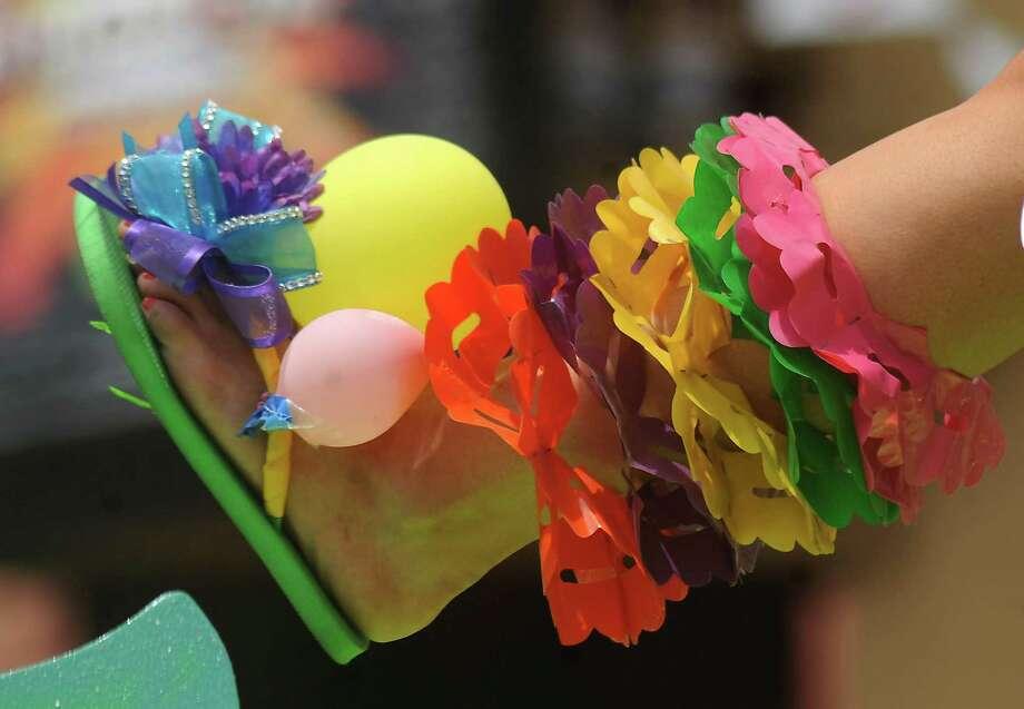 2012 Reina de la Feria de las Flores Alanna Sarabia shows her shoes during the Battle of Flowers Parade on Friday, April 27, 2012. Billy Calzada / Express-News Photo: BILLY CALZADA, SAN ANTONIO EXPRESS-NEWS / San Antonio Express-News