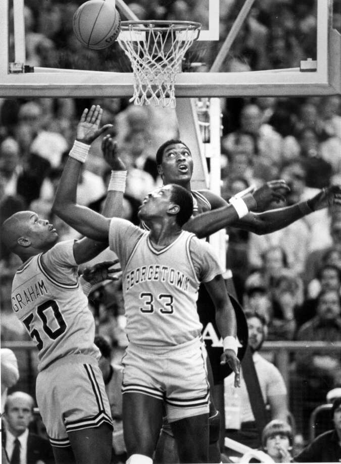 1984:The Final Four came to the Kingdome in 1984, featuring Virginia, Houston, Kentucky and Georgetown. Georgetown won the national championship that year 84-75 over Houston. In this photo, Patrick Ewing (33) and Michael Graham of Georgetown outplay Akeem Olajuwon of Houston in that National Championship Game.