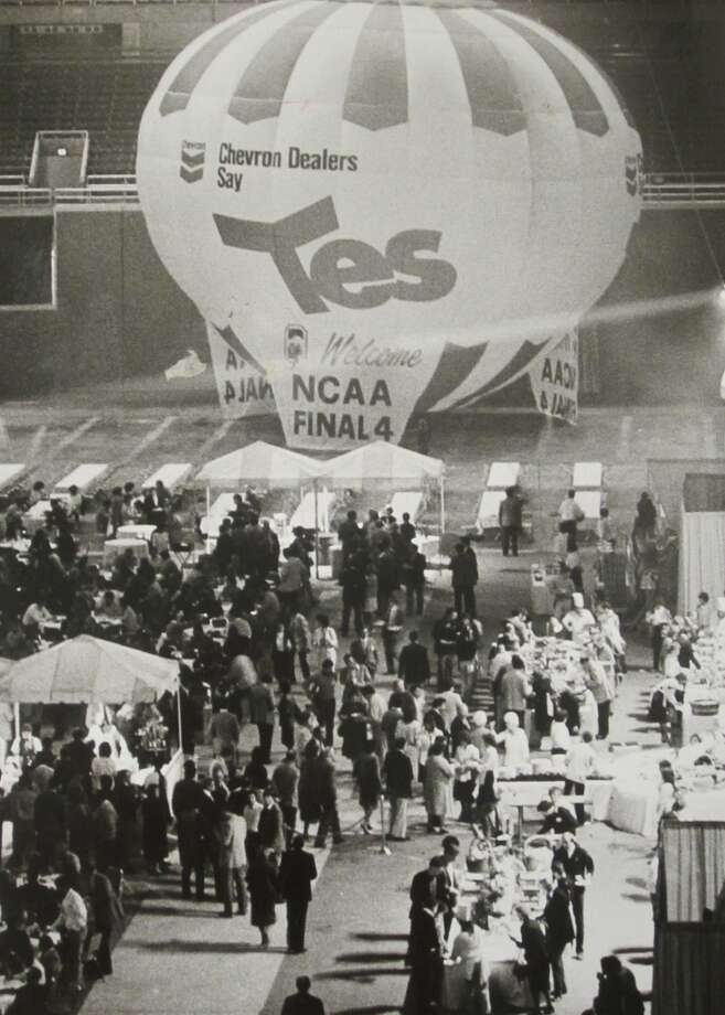 1984:The Final Four at the Kingdome was a big event. The caption of this March 30, 1984, P-I photo reads: ''VIPs gather in front of Chevron's hot-air balloon inside the Kingdome en route to consume a total of 2,000 pounds of barbequed salmon and 15,000 drinks at yesterday's Final Four party.''