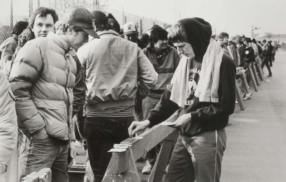 1984: The caption for this March 29, 1984, P-I photo reads: ''Alan McLean, left, and Bruce McLean pass the time with a game of cribbage while waiting to buy Final Four tickets at the Kingdome. The last 1,400 available tickets to the NCAA championships were sold in just over an hour yesterday.''