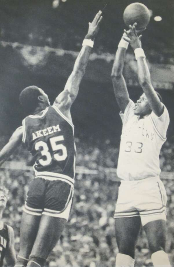 1984:The caption to this April 2, 1984, photo from The Associated Press reads: ''Georgetown's Patrick Ewing (33) shoots for two over the outstretched Akeem Olajuwon Monday during NCAA playoff action at Seattle's Kingdome.''