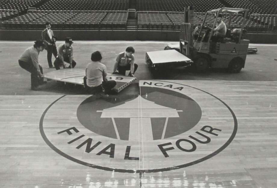 1989: The Final Four returned to the Kingdome in 1989. In this photo, workers install pieces of the basketball court showing the logo for the 1989 Final Four in Seattle. That year, the four teams were Duke, Seton Hall, Michigan and Illinois. Michigan ended up winning the national championship 80-79 over Seton Hall.