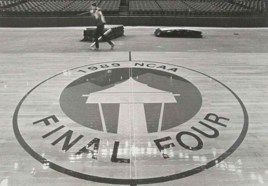 1989: A complete Final Four logo is seen on the court as the playing surface is constructed at the Kingdome on March 28, 1989. According to the P-I archives, the wooden floor cost $50,000 to $55,000.