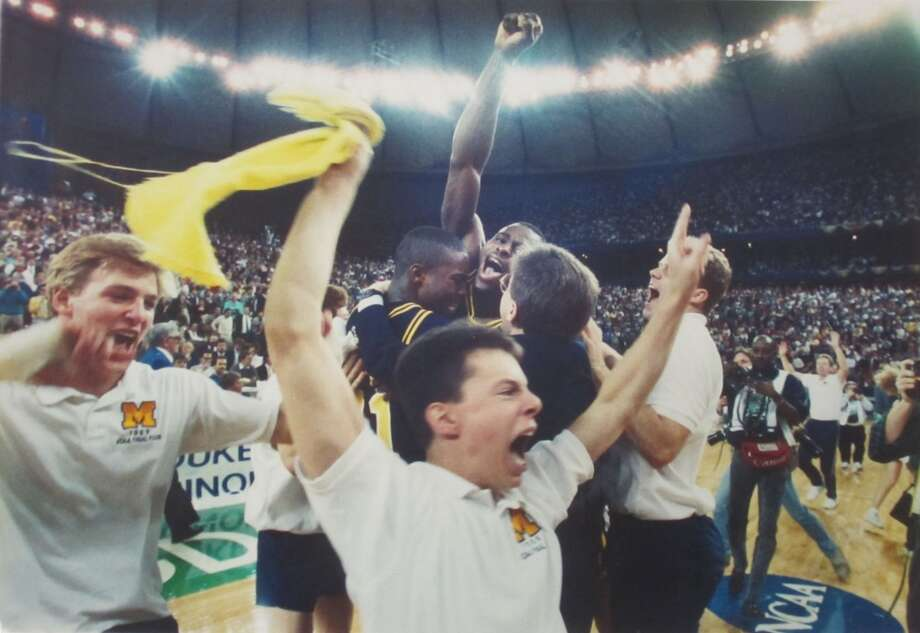 1989: The caption of this April 3, 1989, P-I photo reads: ''Michigan cheerleaders whoop for joy after the Wolverines' victory over Seton Hall in last night's NCAA men's basketball title game in the Kingdome while team members Rumeal Robinson and Glen Rice celebrate in the background.''