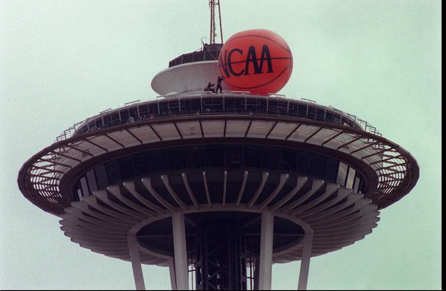 1995:The caption to this March 23, 1995, P-I photo reads: ''Workers atop the Seattle Space Needle install a large basketball, part of the city's growing hoopla over the NCAA Final Four basketball tournament here.''