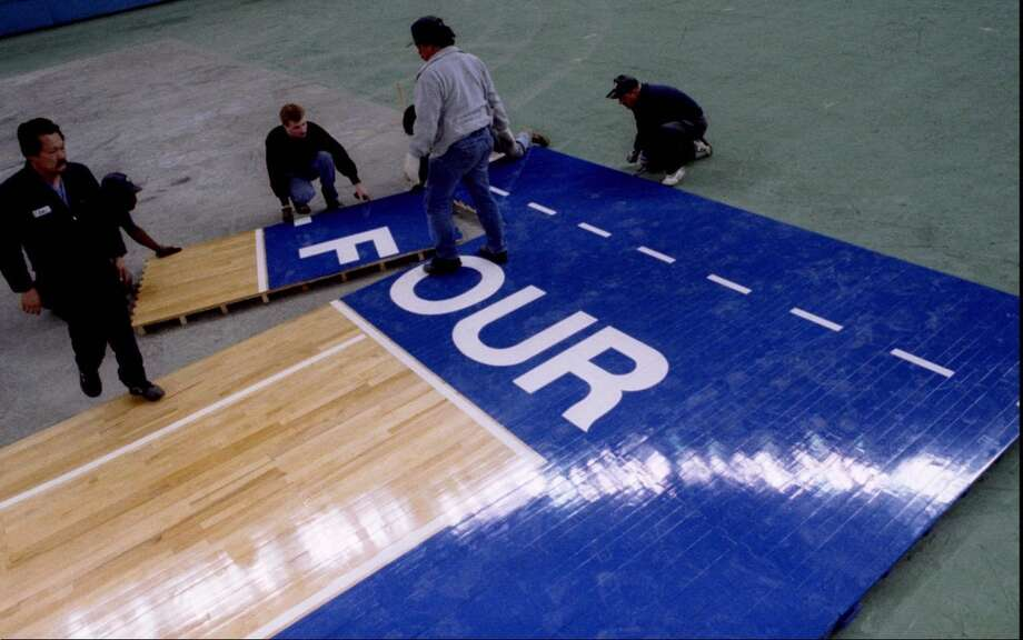 1995: The caption to this March 24, 1995, P-I photo reads: ''Workers at the Kingdome install the 'F' in 'four' as they put together the floor for the NCAA Final Four at the Kingdome, Friday.''