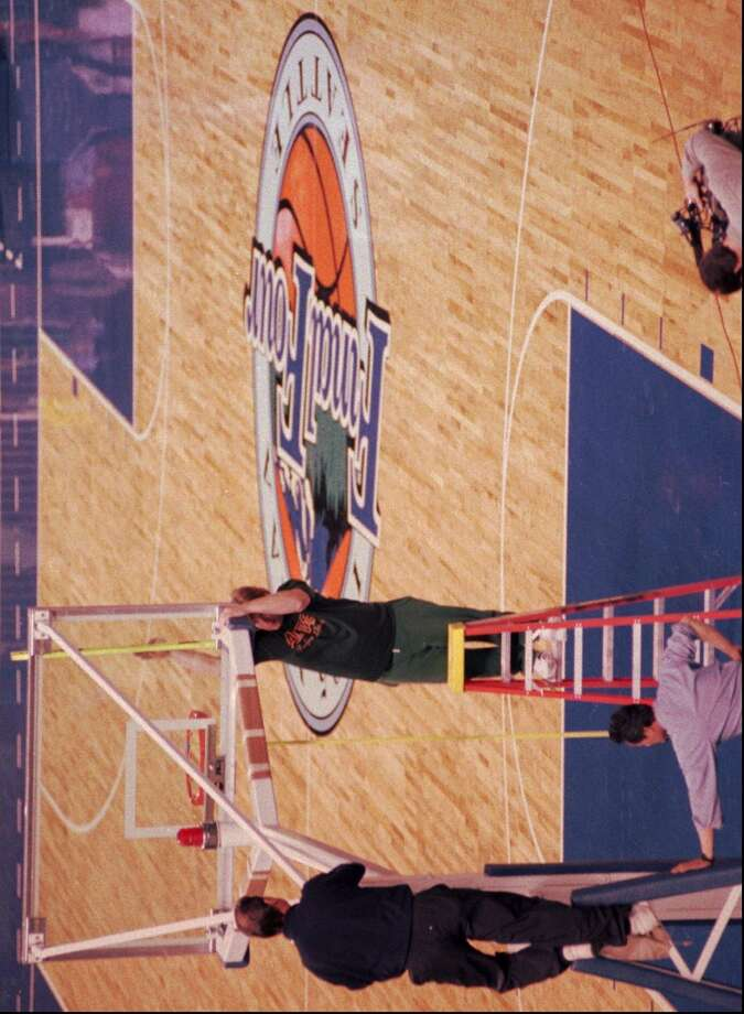 1995:The caption for this March 18, 1995, AP photo reads: ''Bill Austin, left, and Marty Coppo adjust the basket Tuesday at the Seattle Kingdome as they prepare for the NCAA Final Four, which will be held April 1 and April 3. The college championship will feature UCLA, North Carolina, Oklahoma State and Arkansas.''