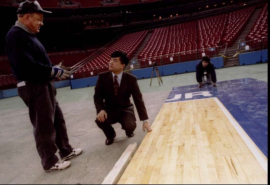 1995:The caption to this March 24, 1995, P-I photo reads: ''Bill Gappy, with Horner Flooring, who is putting in the floor for the NCAA Final Four in Seattle, explains the process to King County Executive Gary Locke, Friday as a workman in background works on the floor.''