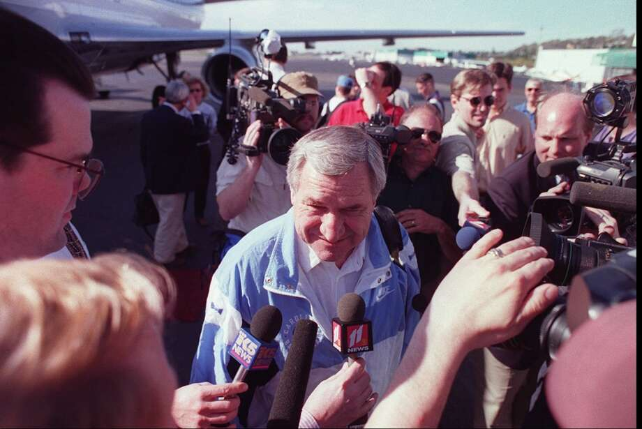 1995:The caption to this March 30, 1995, P-I photo reads: ''North Carolina coach Dean Smith is mobbed by the Seattle media upon arrival of the Tar Heel charter at Boeing Field.''