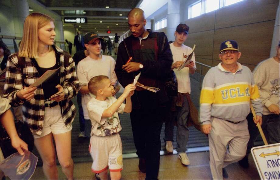 1995: The caption to this March 30, 1995, P-I photo reads: ''UCLA's Ed O'Bannon is mobbed for autographs by Bruins fans on his arrival at Sea-Tac Airport with the team.''