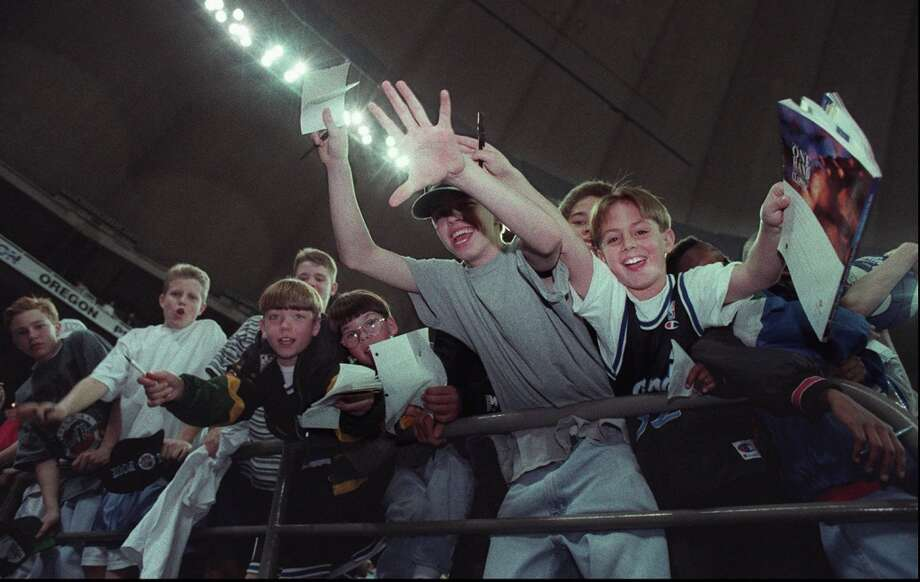 1995: The caption to this March 31, 1995, P-I photo reads: ''Young fans try for autographs in the Kingdome during practices for the Final Four teams.''