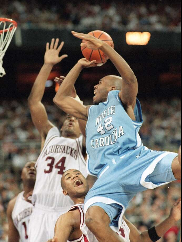1995:The caption to this April 1, 1995, AP photo reads: ''North Carolina's Jerry Stackhouse goes for the basket over Arkansas' Corey Beck as Arkansas' Corliss Williamson (34) defends Saturday, April 1, 1995, during second-half NCAA Final Four semifinal action at the Kingdome in Seattle.'' Arkansas ended up beating North Carolina 75-68.