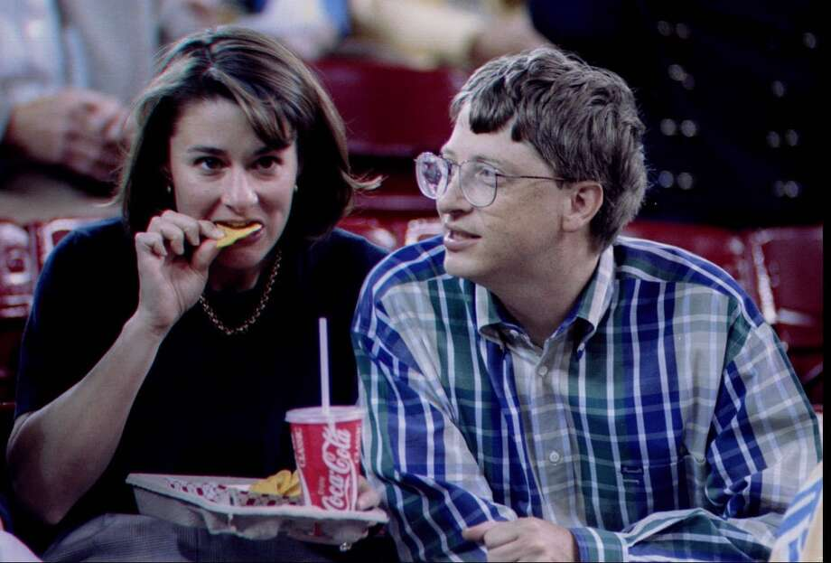1995: The caption to this April 3, 1995, P-I photo reads: ''Bill Gates (right) and his wife, Melinda, enjoy some nachos during the NCAA championship game at the Kingdome Monday night.''