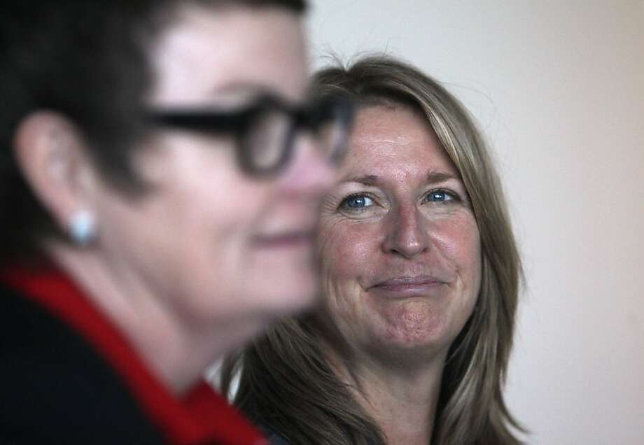 Kris Perry (left) and Sandy Stier of Berkeley are one of the two couples who are fighting to overturn Proposition 8. Photo: Lea Suzuki, The Chronicle