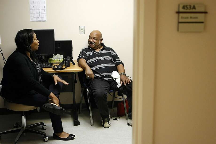 Hervy Luster, who suffers from congestive heart failure, consults with nurse care manager Ursula Haynes at the Hope Center. The Alameda County Medical Center clinic focuses on patients with chronic conditions. Photo: Sean Havey, The Chronicle
