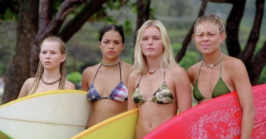 Kate Bosworth (second from right) and Michelle Rodriguez (second from left) spent a lot of time in bikinis in the 2002 movie ''Blue Crush.''