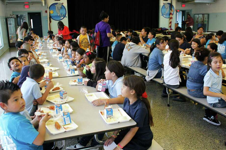 About 150 Port of Houston Elementary School students eat dinner in the school cafeteria in Houston. Photo: Johnny Hanson, Houston Chronicle / © 2013  Houston Chronicle