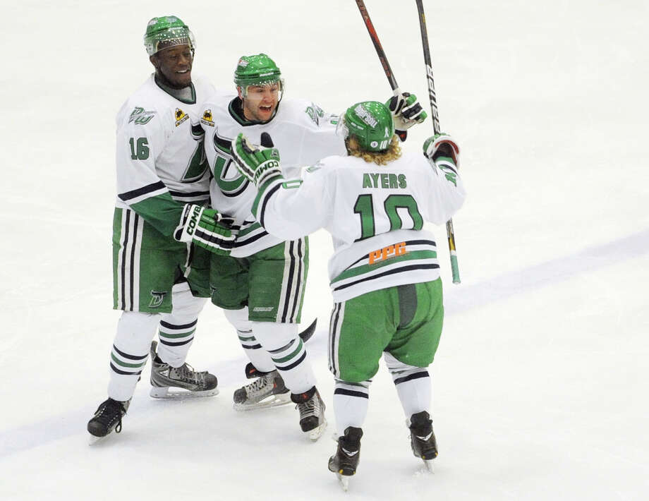 Danbury's Philip Aucoin, center, celebrates his goal with teammates Steve Brown, left, and Cody Ayers in game three of the Commisioner's Cup championship series between the Danbury Whalers and the Dayton Demonz at Danbury Arena in Danbury, Conn. on Friday, March 22, 2013. Photo: Tyler Sizemore / The News-Times