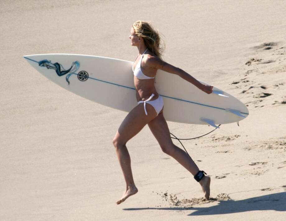 Cameron Diaz gets ready to surf during the filming of ''Charlie's Angels 2'' in Malibu, California.
