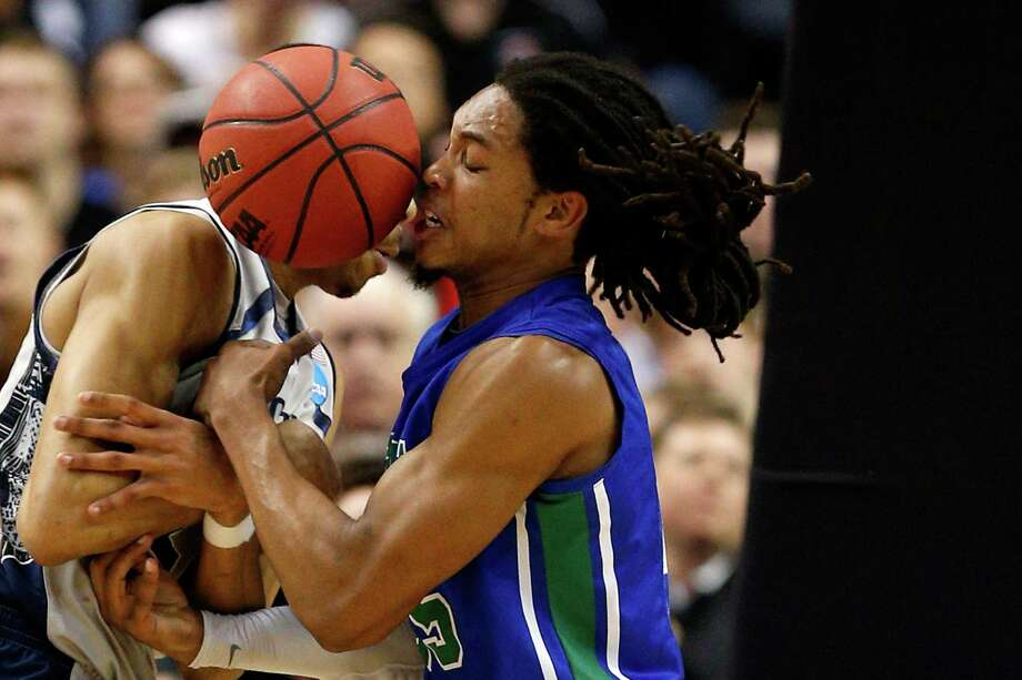 Otto Porter Jr. #22 of the Georgetown Hoyas fights for the ball in the first half against Sherwood Brown #25 of the Florida Gulf Coast Eagles during the second round. Photo: Rob Carr, Getty Images / 2013 Getty Images