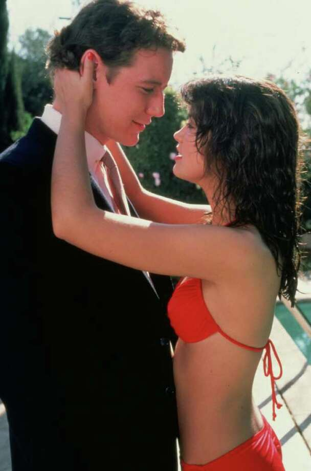 Phoebe Cates, in her red bikini,  was the sex symbol for teenage boys in the '80s, from the movie ''Fast Times at Ridgemont High,''  with Judge Reinhold. Photo: Universal City Studios / handout