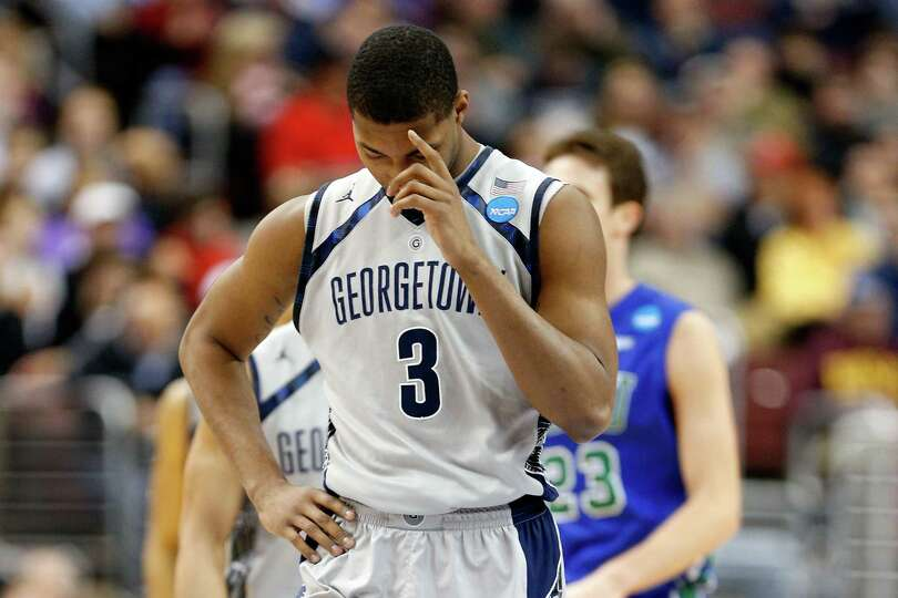 Mikael Hopkins #3 of the Georgetown Hoyas stands on the court in the second half with his head down