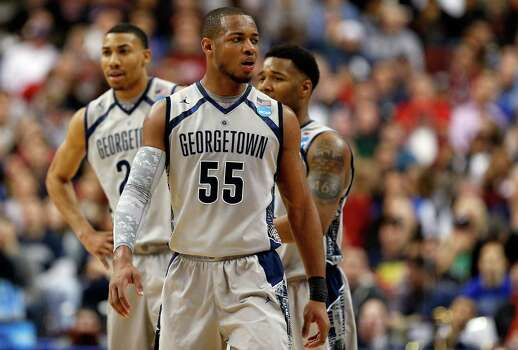 Jabril Trawick #55 of the Georgetown Hoyas looks on in the second half against the Florida Gulf Coast Eagles. Photo: Rob Carr, Getty Images / 2013 Getty Images