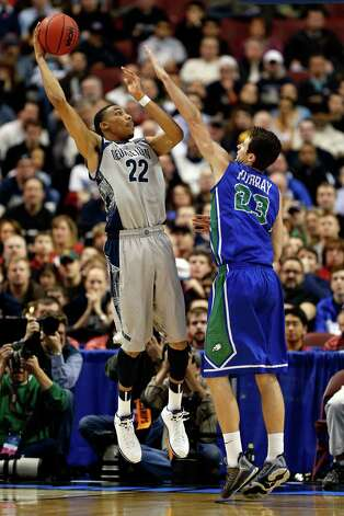 Otto Porter Jr. #22 of the Georgetown Hoyas attempts a shot in the second half against Eddie Murray #23 of the Florida Gulf Coast Eagles. Photo: Rob Carr, Getty Images / 2013 Getty Images