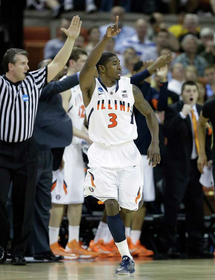 Illinois' Brandon Paul (3) reacts after scoring against Colorado during the second half of a second-round game of the NCAA college basketball tournament on Friday, March 22, 2013, in Austin, Texas. Illinois defeated Colorado 57-49. Photo: Eric Gay