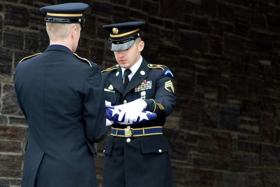 Staff Sgt. Erwin Dominguez, face visible, and Spc. Mark Kinder, both of the New York Honor Guard. They were performing funeral detail for Sergeant Elijah Willette (Bill Winchip)