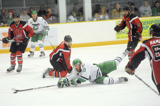 Danbury's Cody Ayers dives after the puck surrounded by Dayton defenders in game three of the Commisioner's Cup championship series between the Danbury Whalers and the Dayton Demonz at Danbury Arena in Danbury, Conn. on Friday, March 22, 2013. Photo: Tyler Sizemore / The News-Times