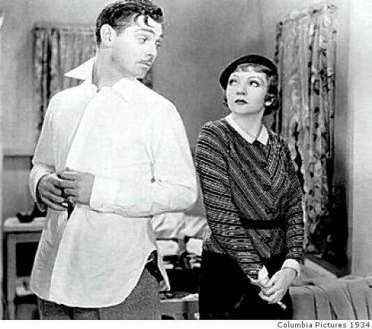 IT HAPPENED ONE NIGHT -- Clark Gable and Claudette Colbert on the road.