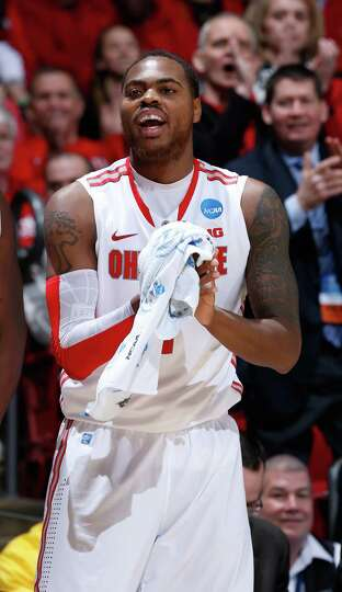 Deshaun Thomas #1 of the Ohio State Buckeyes looks on from the bench late in the game against Iona G