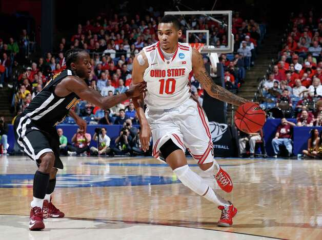 Ohio State 95, Iona 70DAYTON, OH - MARCH 22: LaQuinton Ross #10 of the Ohio State Buckeyes handles the ball against Tavon Sledge #3 of the Iona Gaels in the second half during the second round of the 2013 NCAA Men's Basketball Tournament at UD Arena on March 22, 2013 in Dayton, Ohio. Photo: Joe Robbins, Getty Images / 2013 Getty Images