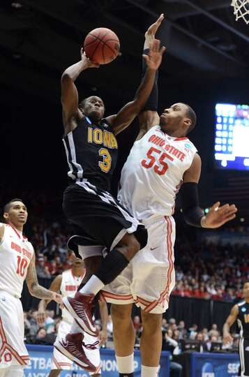 Tavon Sledge #3 of the Iona Gaels drives to the basket against Trey McDonald #55 of the Ohio State B