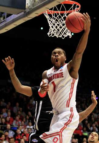 Ohio State forward Deshaun Thomas (1) shoots a reverse layup against Iona in the second half of a second-round game at the NCAA college basketball tournament, Friday, March 22, 2013, in Dayton, Ohio. (AP Photo/Skip Peterson) Photo: Skip Peterson, Associated Press / FR23879 AP