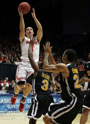 Ohio State's Aaron Craft (4) shoots over Iona's Tavon Sledge (3) in the first half. Photo: Brian Cassella, McClatchy-Tribune News Service / Chicago Tribune