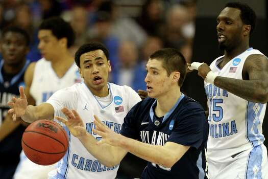 North Carolina 78, Villanova 71KANSAS CITY, MO - MARCH 22: Ryan Arcidiacono #15 of the Villanova Wildcats catches a pass while defended by Marcus Paige #5 and P.J. Hairston #15 of the North Carolina Tar Heels in the second half during the second round of the 2013 NCAA Men's Basketball Tournament at the Sprint Center on March 22, 2013 in Kansas City, Missouri. North Carolina won 78-71. Photo: Ed Zurga, Getty Images / 2013 Getty Images
