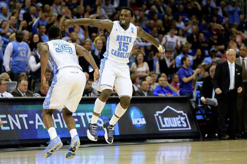 Reggie Bullock #35 and P.J. Hairston #15 of the North Carolina Tar Heels celebrate a moment in the s