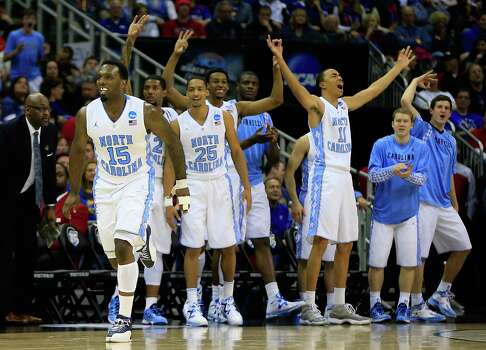 P.J. Hairston #15 of the North Carolina Tar Heels and the bench celebrate in the second half against the Villanova Wildcats. Photo: Jamie Squire, Getty Images / 2013 Getty Images