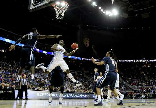 P.J. Hairston #15 of the North Carolina Tar Heels shoots against Mouphtaou Yarou #13 of the Villanova Wildcats in the first half. Photo: Jamie Squire, Getty Images / 2013 Getty Images