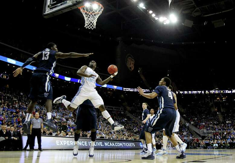 P.J. Hairston #15 of the North Carolina Tar Heels shoots against Mouphtaou Yarou #13 of the Villanov