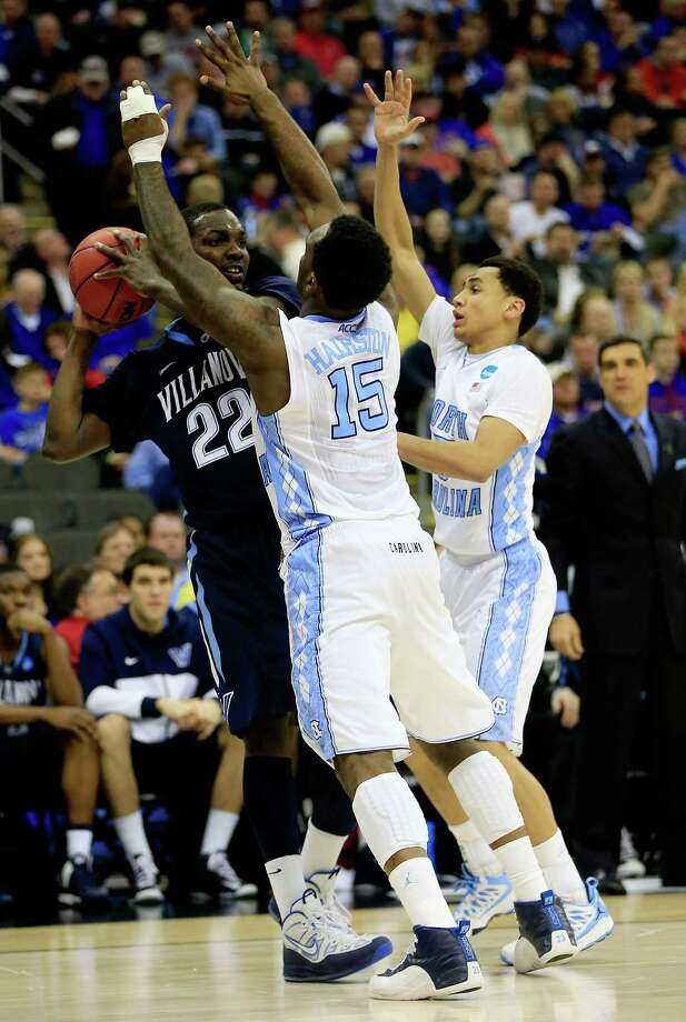 JayVaughn Pinkston #22 of the Villanova Wildcats looks to pass as he is defended by P.J. Hairston #15 and Marcus Paige #5 of the North Carolina Tar Heels in the second half. Photo: Jamie Squire, Getty Images / 2013 Getty Images