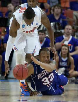 Florida 79, Northwestern St. 47DeQuan Hicks (32) of Northwestern State, bottom and Will Yeguete (15) of Florida battle for a loose ball in the second half of their game in the NCAA Tournament second round game on Friday, March 22, 2013, in Austin, Texas. (George Bridges/MCT) Photo: George Bridges, McClatchy-Tribune News Service / MCT