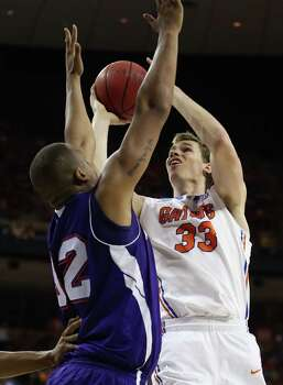 Erik Murphy #33 of the Florida Gators takes a shot over DeQuan Hicks #32 of the Northwestern State Demons. Photo: Ronald Martinez, Getty Images / 2013 Getty Images